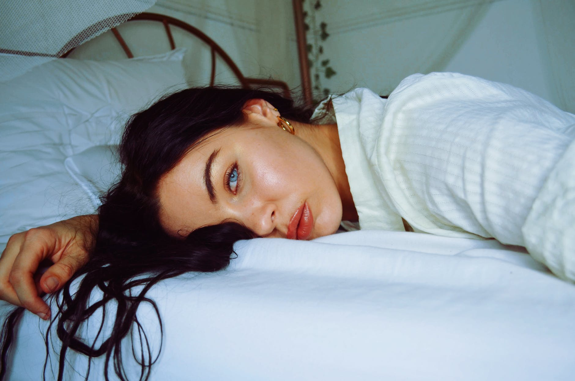 close up photo of woman lying on bed